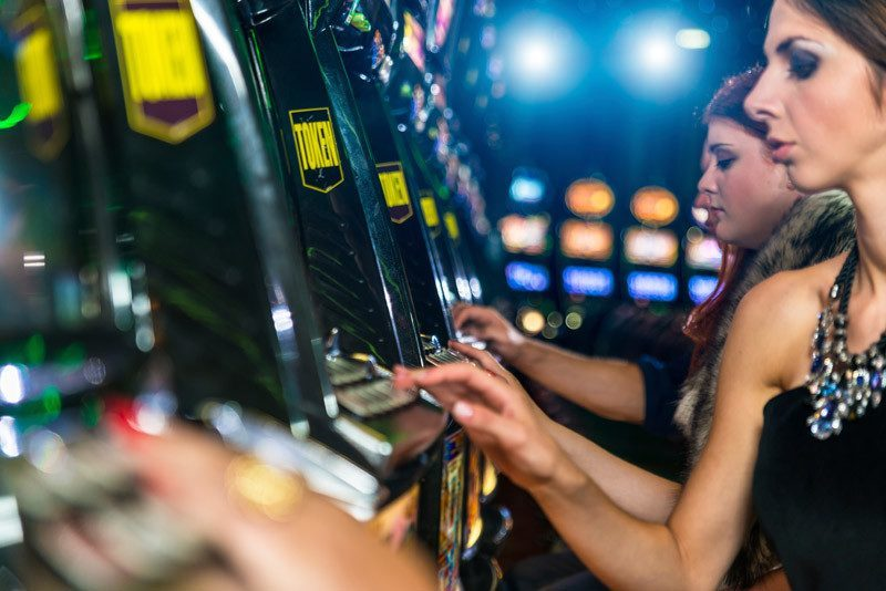 Women gambling at slot machines