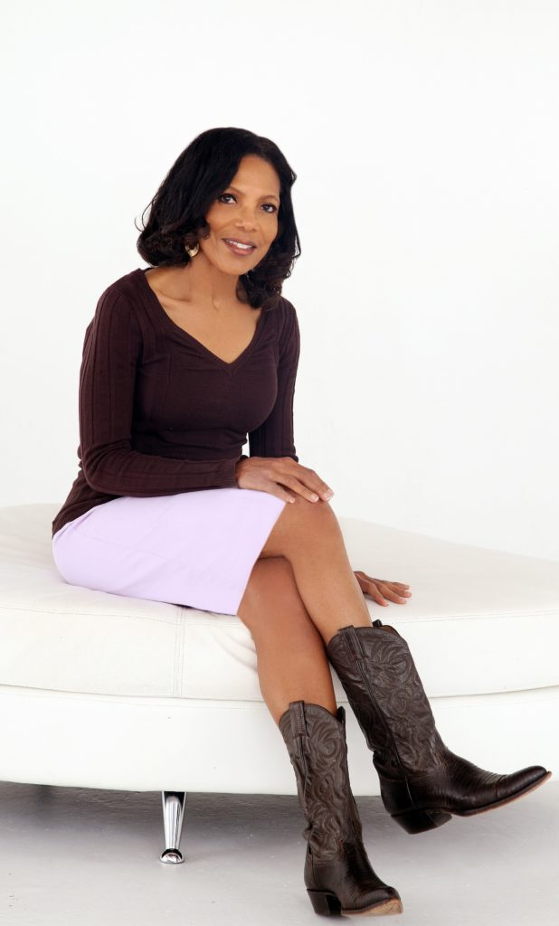Photo of Debra Neal sitting on sofa