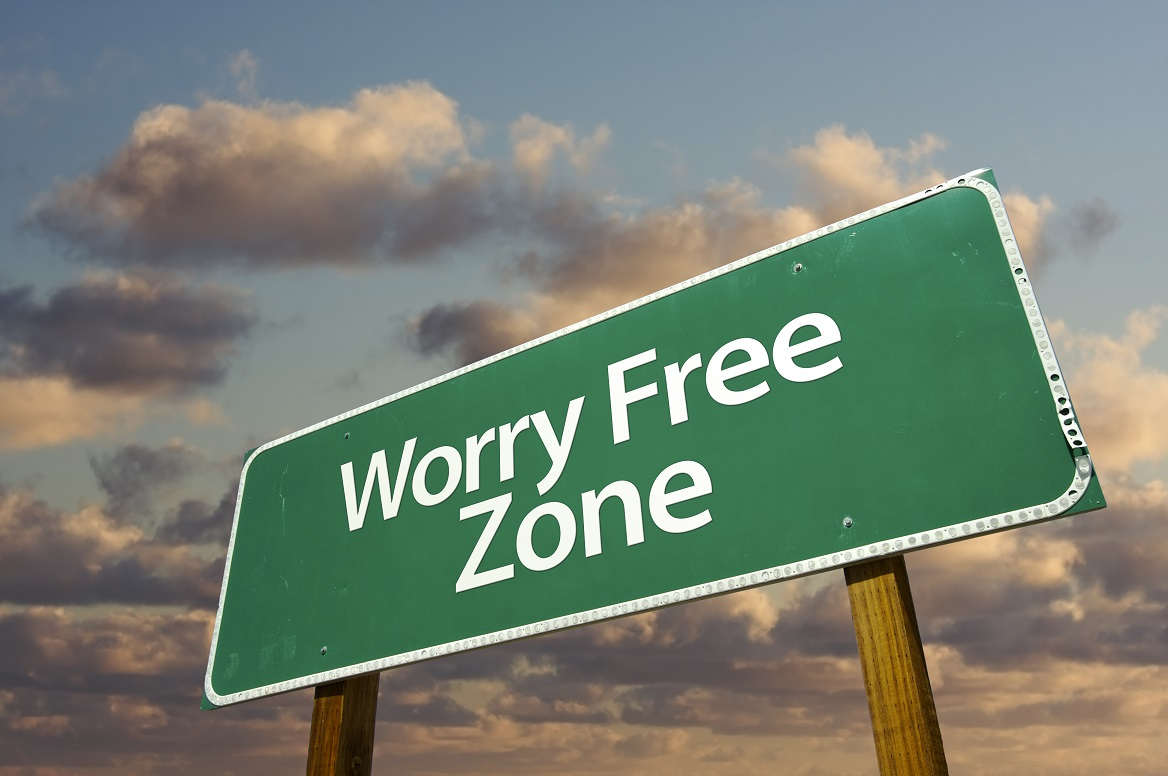 Worry free zone road sign under clouds