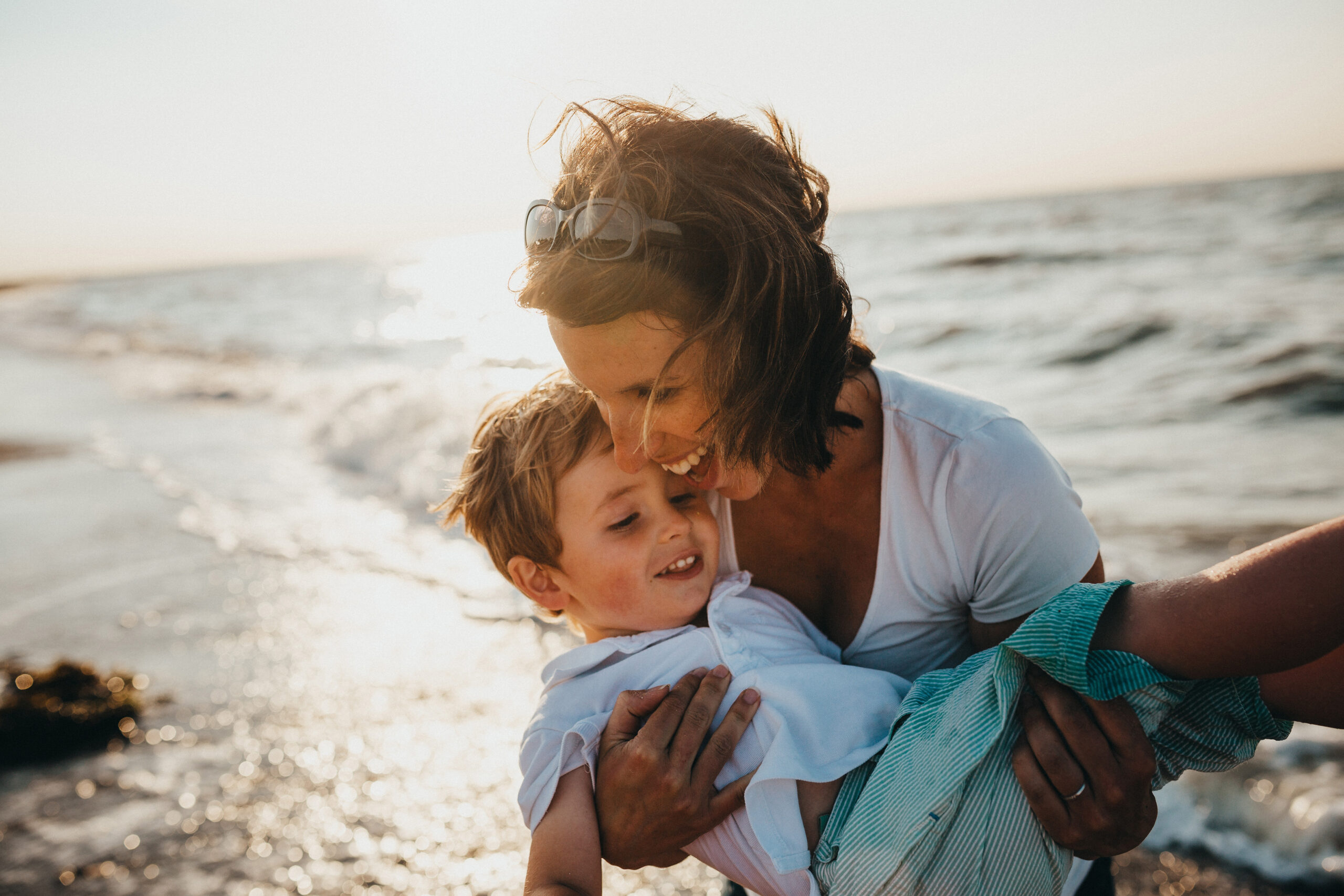 043-caucasian-mother-son-happy-hugging-on-beach